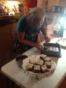 Linda icing the Pumpkin Magic Bars